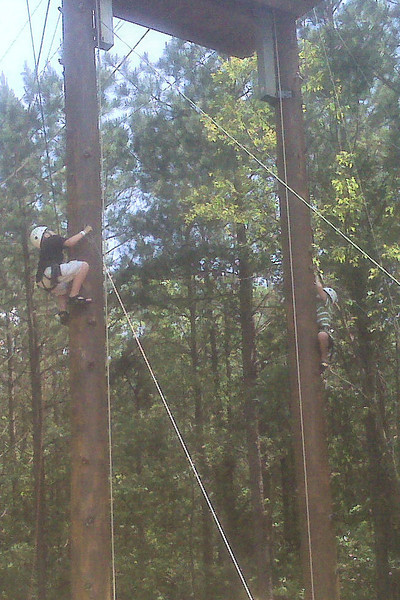 Jacob and Anthony climbing up to the zip line tower at the Whitewater Center.