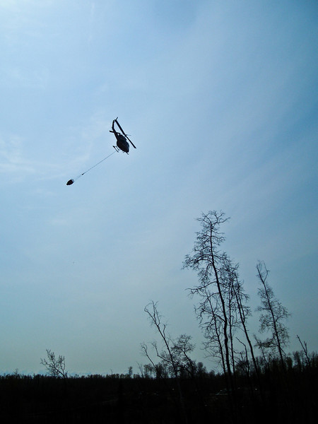 Air support moves out to the fill site to fill the bucket.