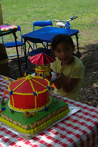 Sofia holding Lily's mini cake