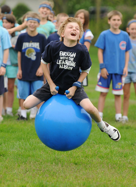 "05/08/09 St. Isaac Jogues School field day at Robbins Park. Fourth grader Christoper Tuchek gets some ""air"" as he competes for the blue team in the ""hipity-hop"" relay.  Photo for the Hinsdalean by Scott Hardesty/starphotos.us   Photos for the Hinsdalean by Scott Hardesty/starphotos.us"
