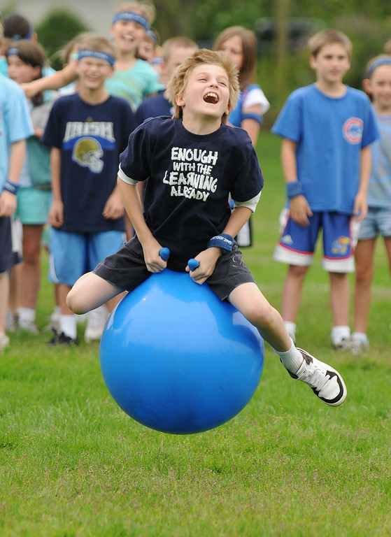 """05/08/09 St. Isaac Jogues School field day at Robbins Park. Fourth grader Christoper Tuchek gets some """"air"""" as he competes for the blue team in the """"hipity-hop"""" relay.  Photo for the Hinsdalean by Scott Hardesty/starphotos.us   Photos for the Hinsdalean by Scott Hardesty/starphotos.us"""