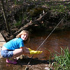 Alyssa Cleaning the river at Grandpa the Great Kraai......