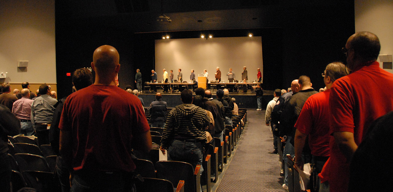 The meeting opens with the Pledge of Allegiance.