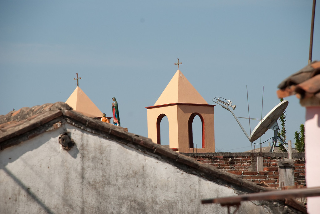 Jesus and satellite TV keep watch over the town.