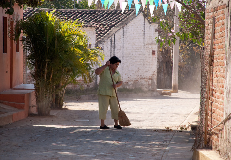 It takes a certain frame of mind to sweep a dirt & cobble street 'clean'...