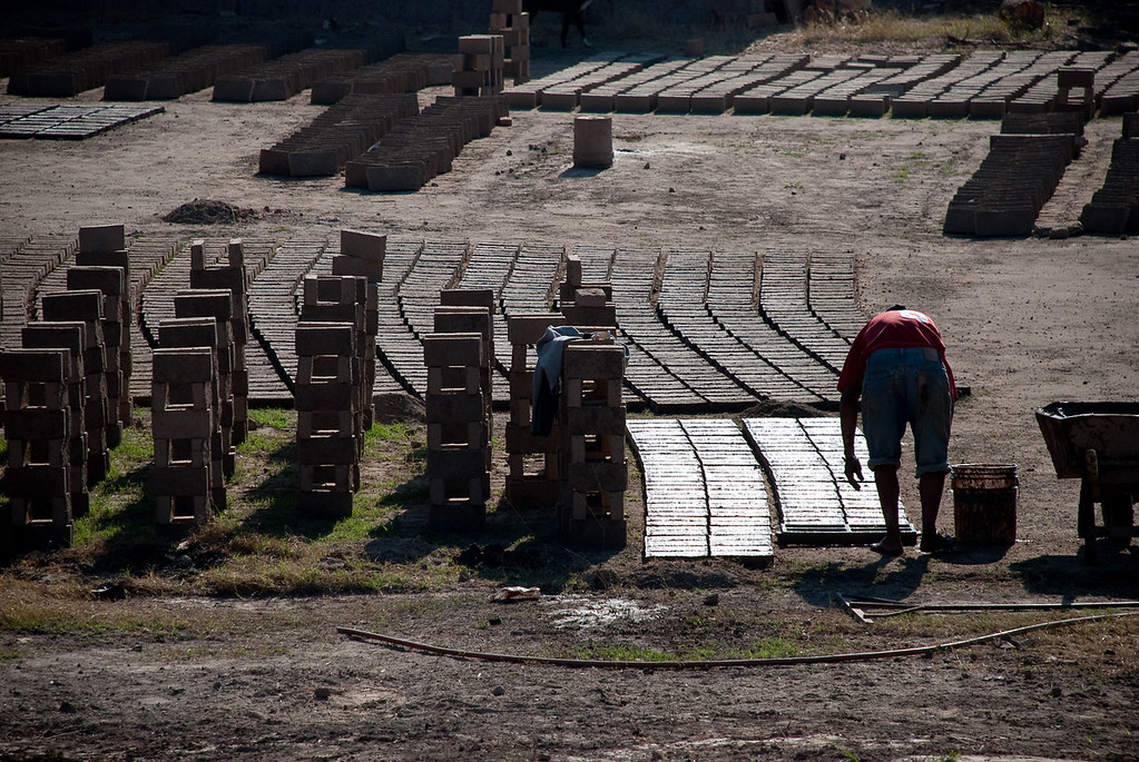 Hand-made bricks, being made by hand...