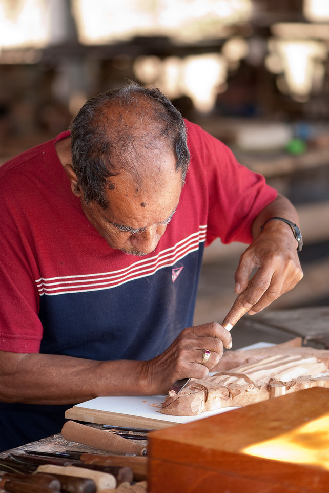 This guy was carving details for furniture.