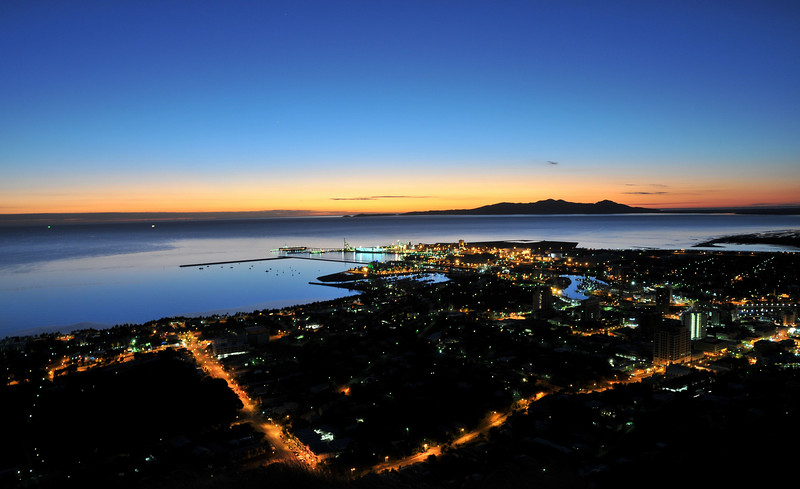 Sunrise, from castle hill, over Townsville City and marina