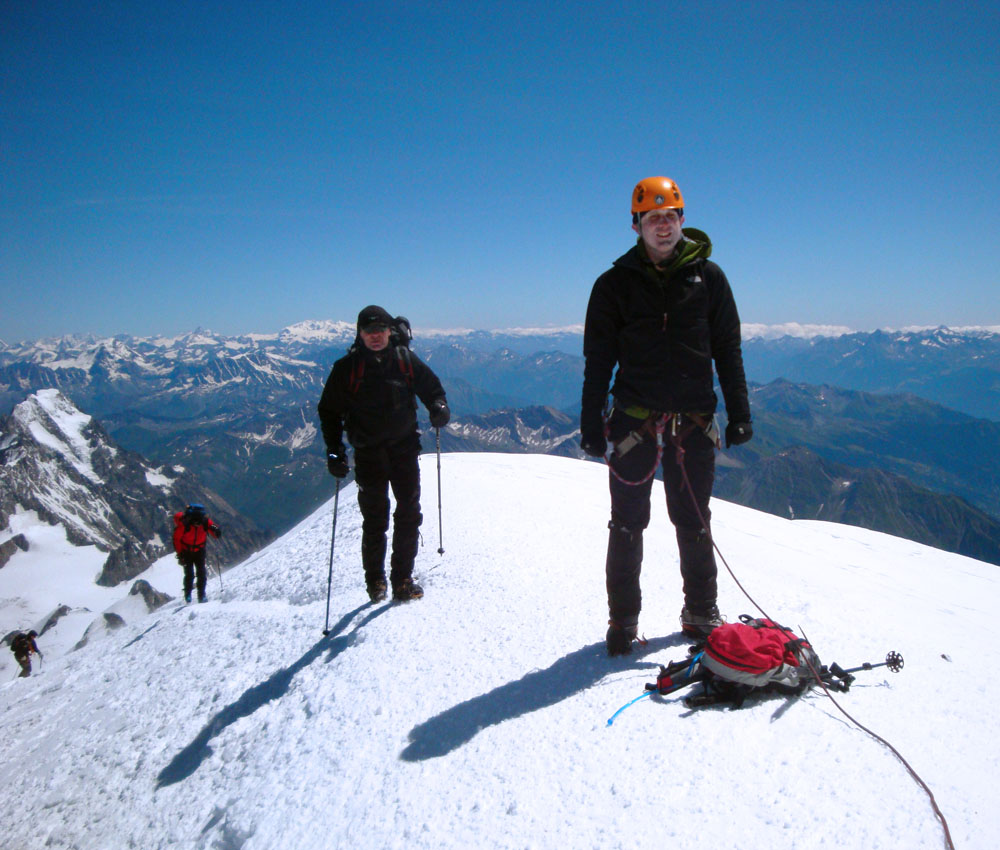 Mt Blanc summit, 4,807 m - the highest in Europe. Due to insufficient acclimatisation and fitness, the altitude hit me 200m below the summit. I suddenly felt very light-headed, almost asleep, and exhausted from the endless vertical stepping with very few breaks. My guide - to whom I was roped - refused to stop(!) so I twice had to sit and briefly refuse to move. The wind was gusting 60-70 km/h and the T was probably around -10C - fantastic conditions for Mt Blanc. Finally, I emerged from a haze of misery onto the summit.
