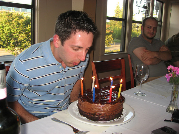 Trying to blow out my candles. Sasha had to use Hanukkah candles that didn't want to blow out!