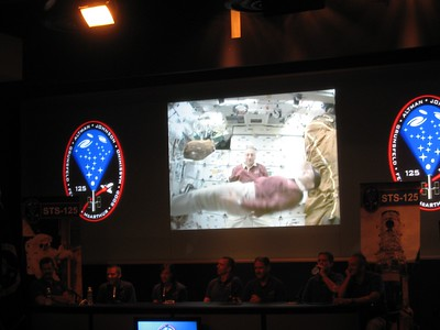 The crew narrates a 20-minute recap video of their mission.  Here, Pilot Greg Johnson experiments with weightlessness while Mission Specialist 4 Mike Massimino looks on.