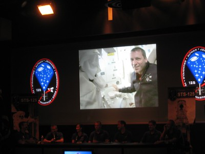 The crew narrates a 20-minute recap video of their mission.  Here, Pilot Greg Johnson explains the Space Shuttle Waste Collection System (space toilet).