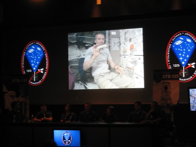 The crew narrates a 20-minute recap video of their mission.  Here, Mission Specialist 5 Drew Feustel makes a tortilla.