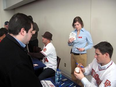 Nationals left fielder Josh Willingham autographs a baseball for Craig