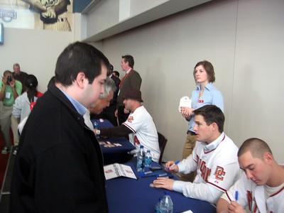 Nationals pitcher Scott Olsen autographs a baseball for Craig