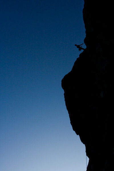 Dane Ketner scopes out the rest of the rappel on his way down from the F.A. of <i>Rise 5.9</i>.
