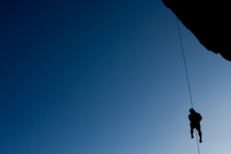 The sky darkens overhead as Kelsey Gray starts to head home after a long day on the rocks.