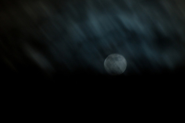 I was having some people over for a small New Years Eve gathering and while taking the trash out I noticed that the clouds made an AWESOME blue moon. I grabbed my tripod and snapped away