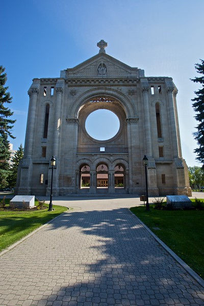 The front of the cathedral of Saint-Boniface, which was otherwise destroyed by fire on 22nd July 1968. The new cathedral, which is a concrete structure supposed to be reminiscent of a wig-wam or tee-pee, can be glimpsed through the open doorways.