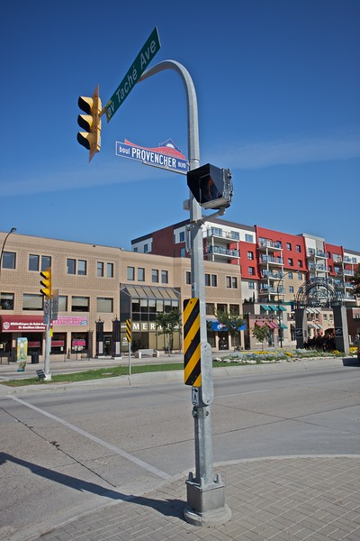 A bilingual street-sign in Saint-Boniface, which used to be a separate French-speaking city, but was incorporated into the city of Winnipeg on 1st January 1972. Note that like many such blingual signs in Canada, the word which identifies a given street is in the centre with the French designation before it and the English after it. Hence a francophone can read 'av. Taché' and 'boul. Provencher', while an anglophone reads 'Taché Ave.' and 'Provencher Boul.'.