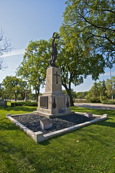 A monument to the fallen French and French-Canadian soldiers of the two world wars, given to the city of Saint-Boniface (later incorporated into Winnipeg) by the French Government. A description of the monument appears underneath it, in both languages:<br /> <br /> Œuvre du sculpteur Eugène Bénet, le monument du Poilu (nom populaire des soldats français en 1914–1918) fut donné par la France aux anciens combatants français et canadiens pour commémorer leurs camarades de l'ouest canadien tombés au champ d'honneur pendant la guerre de 1914–1918. Il fut érigé en 1931. Les noms des disparus de la guerre de 1939–1945 y furent ajoutés. Ce monument a été rénové à l'initiative des anciens combattants français de Winnipeg.<br /> <br /> This monument known as 'Le Poilu' (a popular name for French soldiers in 1914–1918), is the work of sculptor Eugène Bénet. Erected in 1931, it was given by France to French and Canadian war veterans in memory of their comrades of the Canadian West, who gave their life in World War I. The names of those who fell in World War II were subsequently added. The monument has been renovated at the initiative of French veterans of Winnipeg, Royal Canadian Legion, Branch No. 15.
