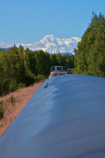 Mount McKinley disappears behind my train as we travel south.
