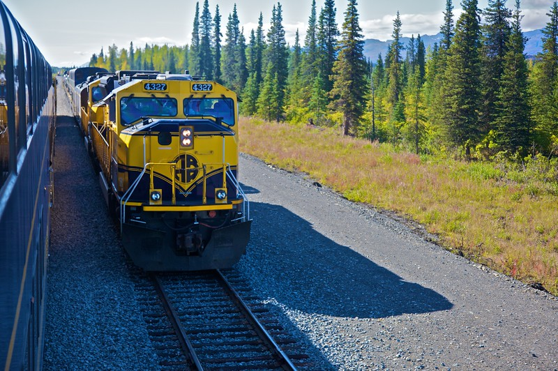 The Alaska Railroad's Denali Star train runs between Anchorage and Fairbanks, taking 12 hours to cover the 350-mile trip. The train runs once daily in either direction during the summer months; at the half-way point—south of the Denali Park station—the two trains meet and stop to transfer some of the staff.