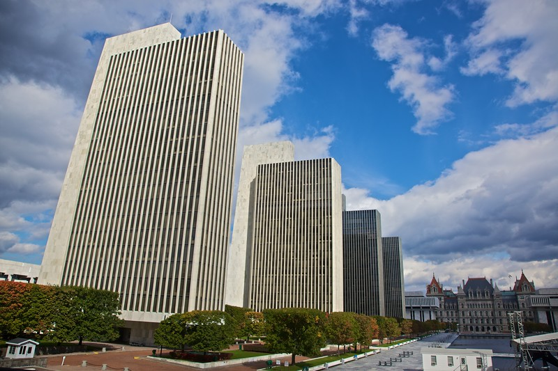 State government buildings in the Rockefeller Empire State Plaza in Albany. At the end of the pond you can see the State Capitol building.