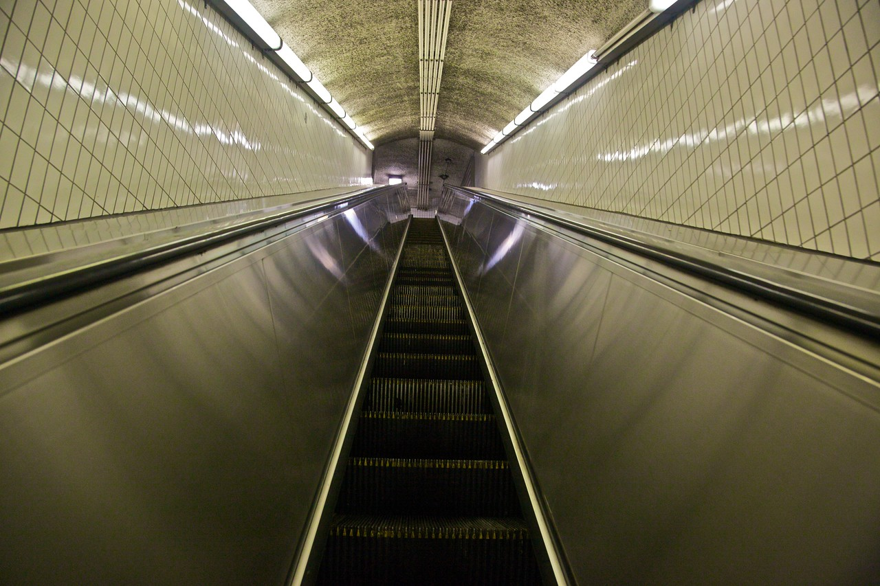 Looking up a narrow escalator at one of the Boston 'T' stations.