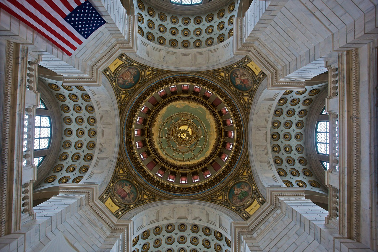 The ceiling of the rotunda in the Rhode Island State House. The four figures are the personifications of Justitia, Educatio, Commercium, and Litera.