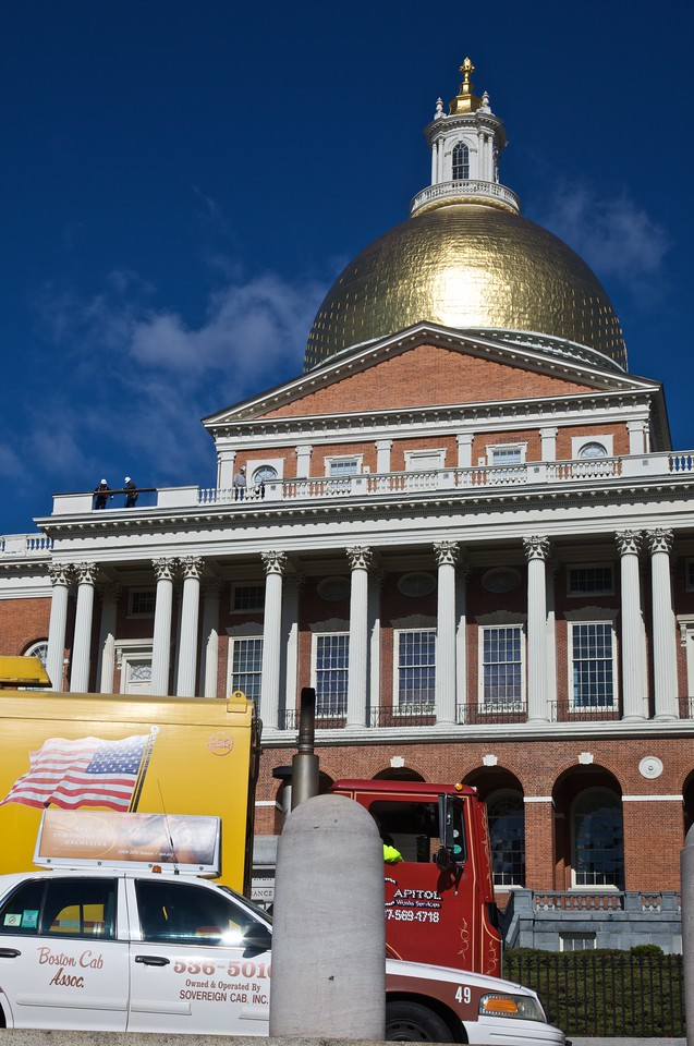 Traffic passing the Massachusetts State House.