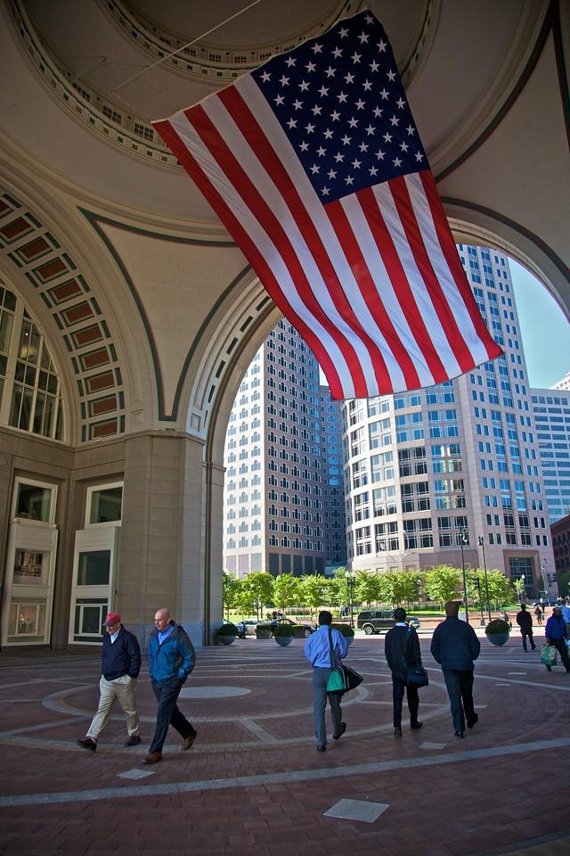 An enormous U.S. flag next to Boston's waterfront.