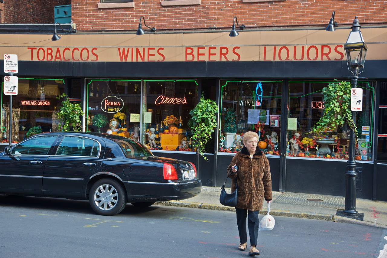 A woman leaves a large grocery in the Italian neighbourhood of Boston.