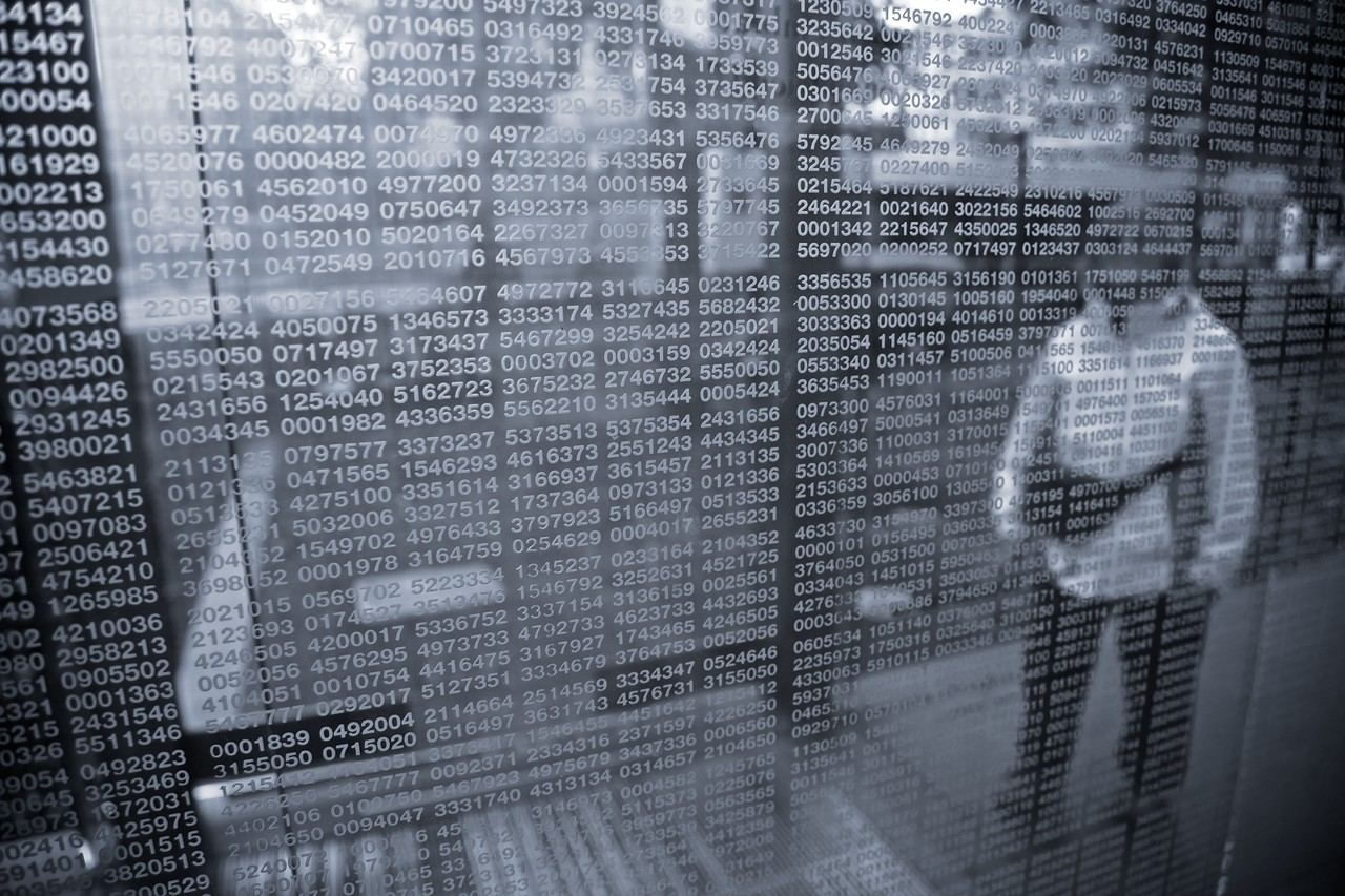 A woman enters one of the pillars of steam in the New England Holocaust Memorial in Boston. The numbers etched on to the glass pillars (in Helvetica) are reminiscent of the numbers given to Jewish and other prisoners by the Nazis.