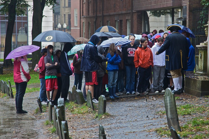 Even though the rain was pouring, the tours of the old burying grounds (including the period costume) continued. Those school children do not look particularly happy, however.