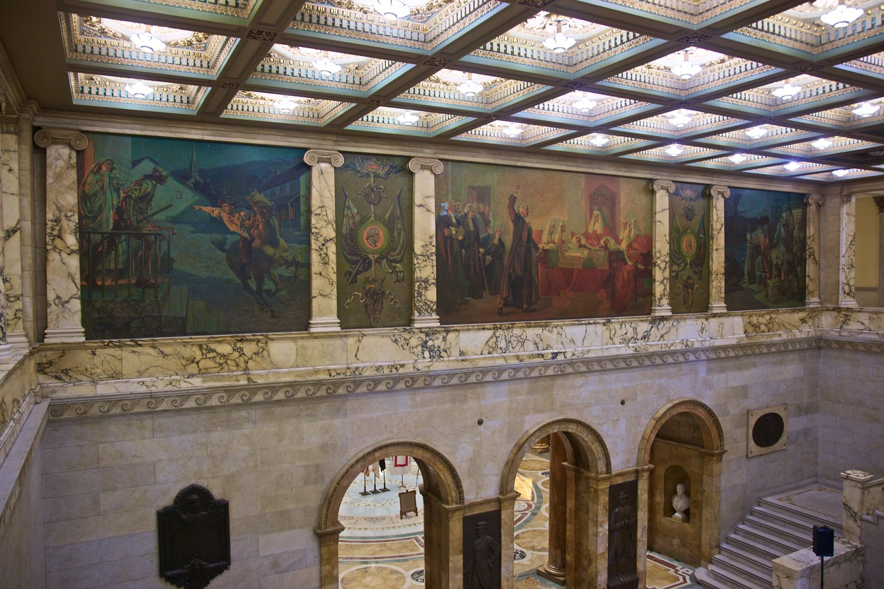 Commemorative murals in a hall of the Massachusetts State House.