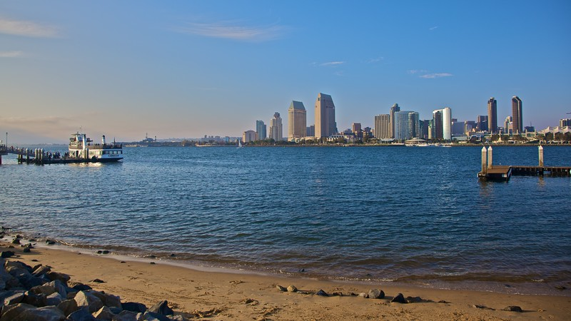 San Diego as seen from Coronado, an isthmus connected to the town by the Coronado Bay Bridge. At the left of the photo you can see the ferry which runs hourly in either direction between San Diego and Coronado.