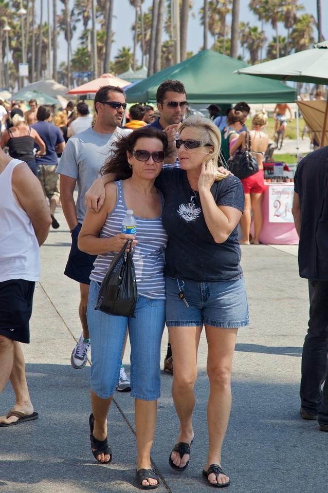 Women walking along the Venice Boardwalk, in Venice—a satellite city of Los Angeles.