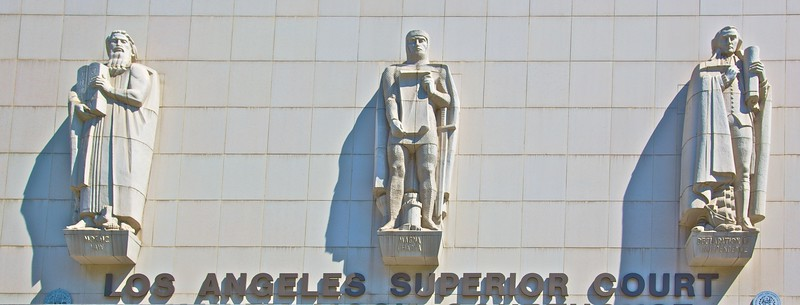 The three statues above the door of the Los Angeles Superior Court: representing Mosaic Law, Magna Carta, and the Declaration of Independence. It feels slightly un-American to me—even if it is of course justified—that they should put such importance on both the Mosaic law (since the Constitution provides for independence of religion) and on the Magna Carta.