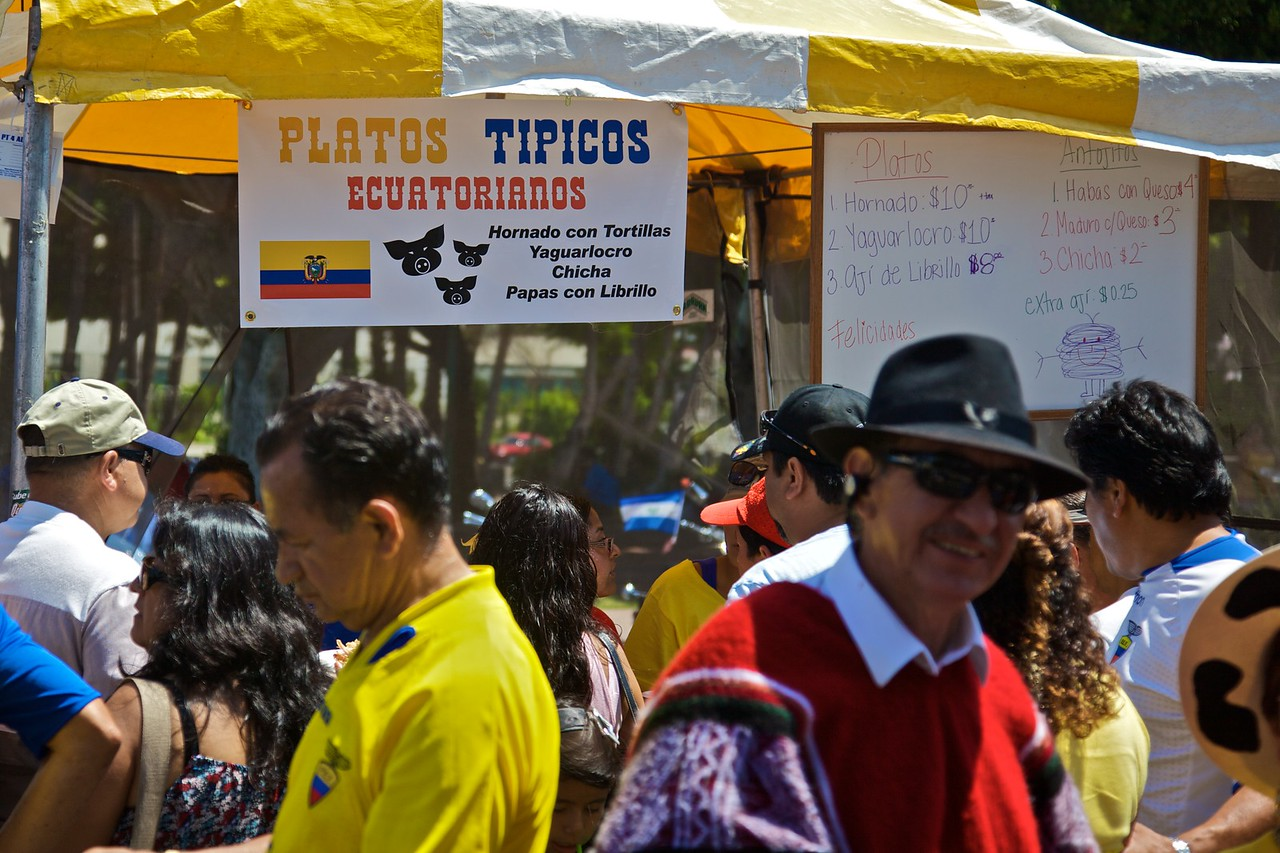 People, including a man in traditional dress, in front of a food stall at the celebration of the bicentenary of Ecuadorean independence in the Pueblo de Los Angeles on Sunday 9th August 2009.