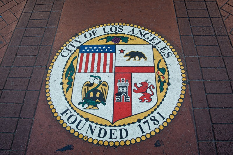 The seal of the city of Los Angeles on the road next to City Hall.