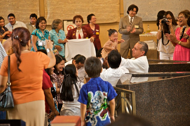 An infant baptism at the back of the cathedral of Our Lady of the Angels in Los Angeles in the afternoon of Sunday 9th August 2009.
