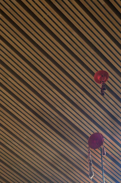 Cardinals' hats hanging above the cathedra in the cathedral of Our Lady of the Angels in Los Angeles.