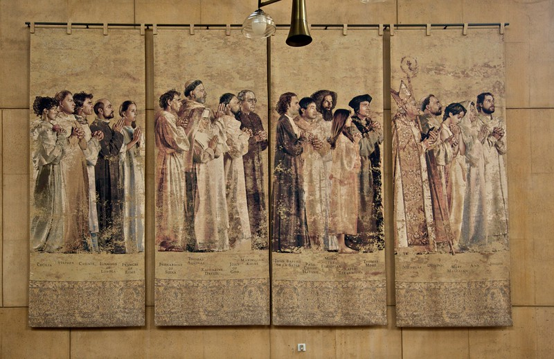 Saints in the cathedral of Our Lady of the Angels, Los Angeles: Cecilia, Stephen, Casimir, Ignatius of Loyola, Frances of Rome, Bernardine of Siena, Thomas Aquinas, Katharine Drexel, John of God, Maximilian Kolbe, John Baptist de la Salle, Paul Chong Hasang, Moses the Ethiopian, Kateri Tekakwitha, Thomas More, Nicholas, Dominic, Mary Magdalen, Ann, and Joseph.