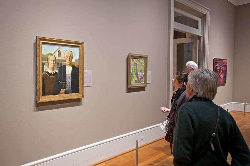 "At the Art Insitute of Chicago: visitors with Grant Wood's (1895–1941) 'American Gothic' (1930). I hadn't previously taken in how prominent this is in American artistic consciousness—it is seen as an icon of 19th-century Americana.  In '<a href=""http://en.wikipedia.org/wiki/Bart_gets_an_elephant"" title=""Bart Gets an Elephant - Wikipedia, the free encyclopedia"">Bart gets an elephant</a>' (S05E17), we learn that the Simpsons had this painting in their home, at least until Bart inadvertently scrubbed it so hard that he revealed Grant Wood's message underneath the paint, 'If you can read this, you scrubbed too hard.'"
