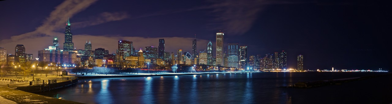 Panorama of the Chicago downtown skyline at night, looking across the edge of Lake Michigan. (Four-photo stitch.)<br /> <br /> I was out taking these photso for about forty minutes. The temperature was 4ºF (minus 16.6ºC): during the day it had risen to a high of 7ºF (minus 14ºC). Fortunately I had procured some thermal underwear in the afternoon in anticipation of my evening standing on the icy shore of an icy lake.
