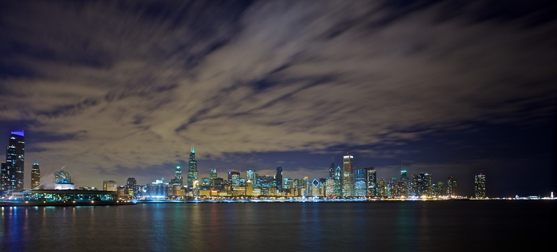 Clouds pass over the skyline of downtown Chicago, on the shore of Lake Michigan.