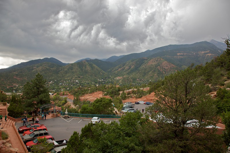A wet day in central Colorado: you can see rain falling in the distance beyond the car park for the Manitou Cave Dwellings.