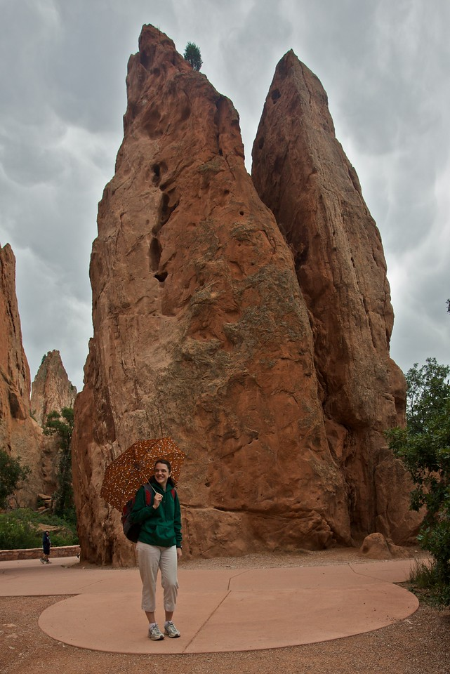 Elizabeth at the Garden of the gods. My flimsy little umbrella, which I bought in Manor in Geneva, has little going for it other than its compact size. And the fact that it's good for posing in photographs.