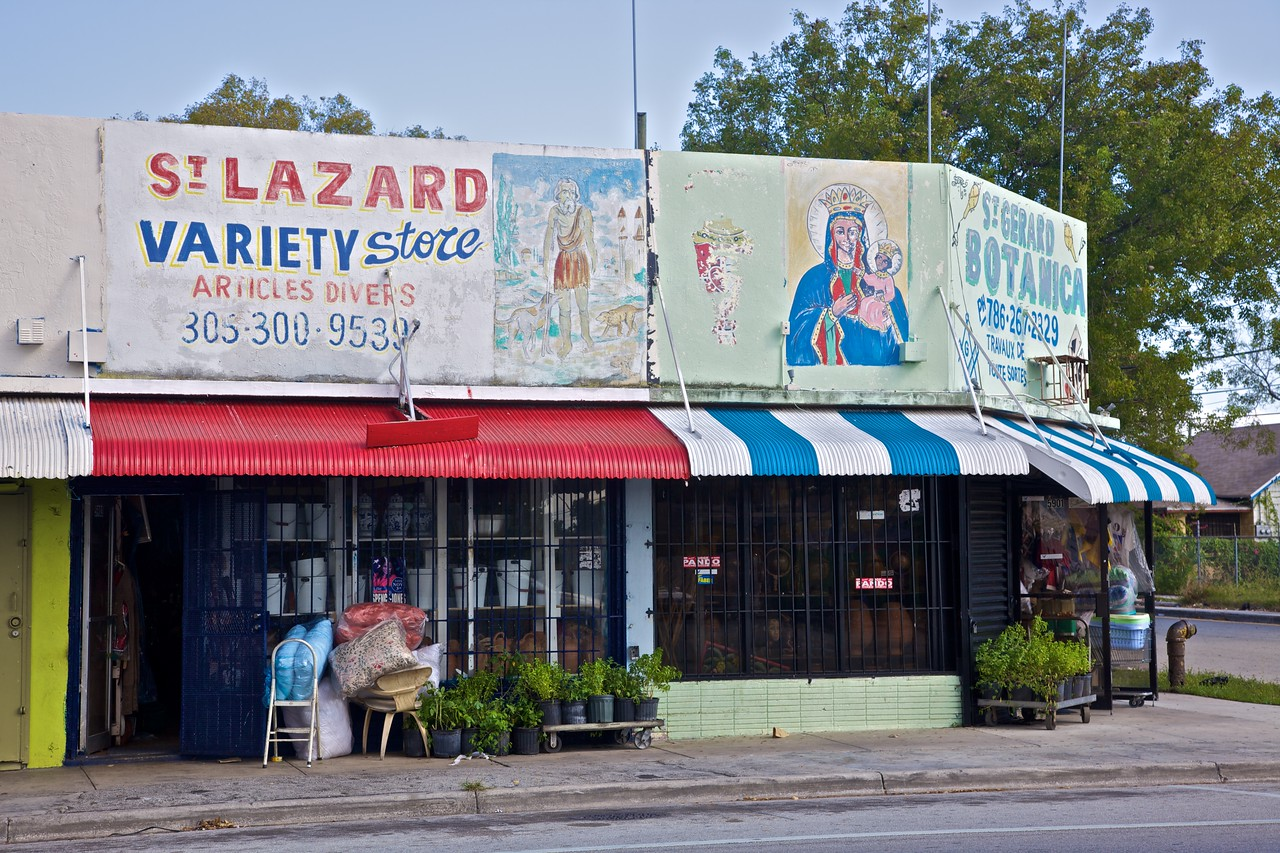 """Shops and painted notices in the <a href=""""http://en.wikipedia.org/wiki/Little_Haiti"""" title=""""Little Haiti, Miami - Wikipedia, the free encyclopedia"""">Little Haiti</a> neighbourhood of Miami."""